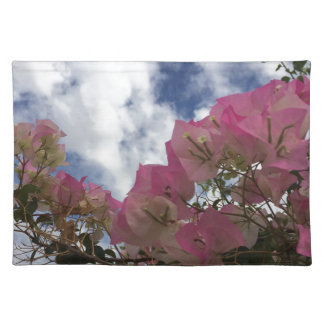 pink flowers against a blue sky placemat