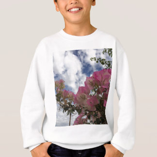pink flowers against a blue sky sweatshirt