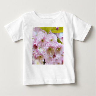 Pink flowers on Japanese cherry tree in city garde Baby T-Shirt