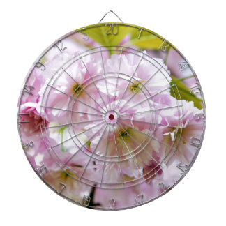 Pink flowers on Japanese cherry tree in city garde Dartboard