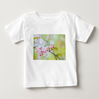 Pink flowers on the bush. Shallow depth of field. Baby T-Shirt