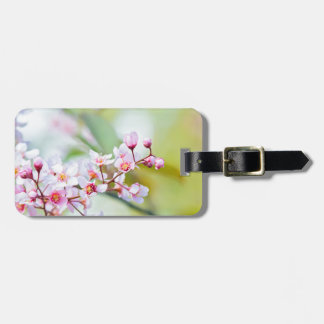 Pink flowers on the bush. Shallow depth of field. Luggage Tag