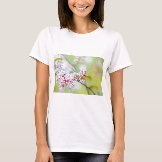 Pink flowers on the bush. Shallow depth of field. T-Shirt