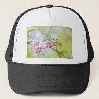 Pink flowers on the bush. Shallow depth of field. Trucker Hat