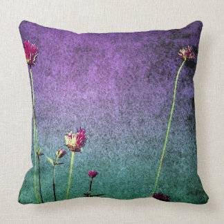 pink flowers on vibrant blue and green background throw pillow