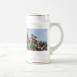 Pink flowers with a blue sky coffee mug