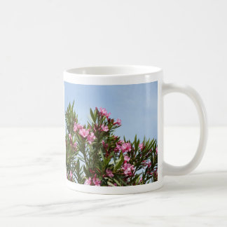 Pink flowers with a blue sky coffee mugs