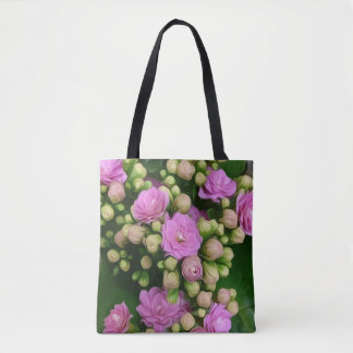 Pink flowers with yellow buds on green background tote bag