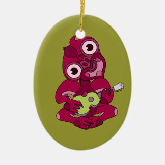 Pink Hei Tiki playing ukelele Ceramic Oval Ornament