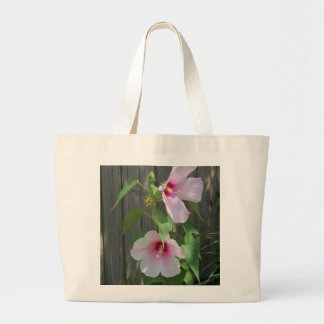 Pink on pink duo of hibiscus flowers large tote bag
