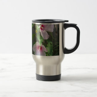 Pink on pink duo of hibiscus flowers travel mug