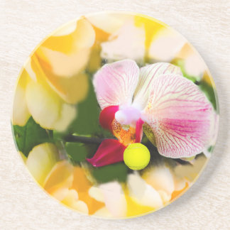 Pink orchid with tennis ball coaster