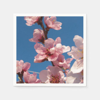 Pink peach blooms with sunny blue sky disposable napkin