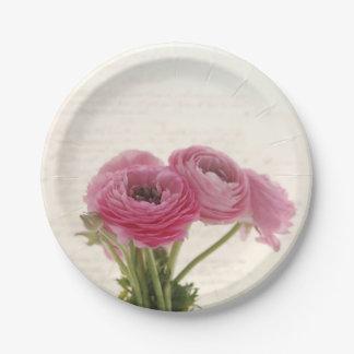 Pink ranunculus flowers on script paper plate