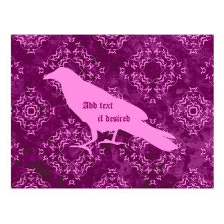 Pink raven on pink and purple geometric damask postcard