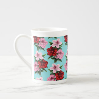 pink red flowers on teal light tea cup