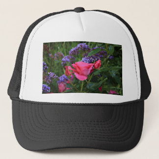 Pink rose and statice in garden trucker hat
