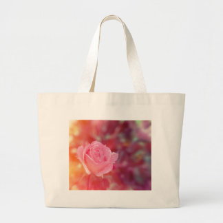 Pink rose covered by morning dew large tote bag