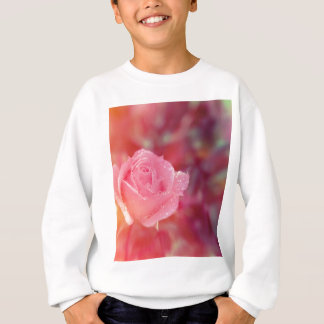 Pink rose covered by morning dew sweatshirt