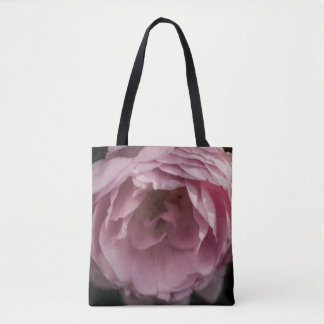 Pink rose in the darkness tote bag