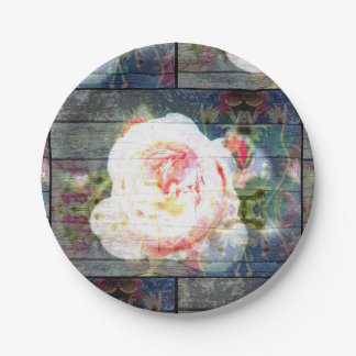 Pink Rose paper plate with wood look background.