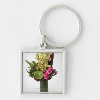 Pink roses, green anthuriums, cymbidium orchids key chains
