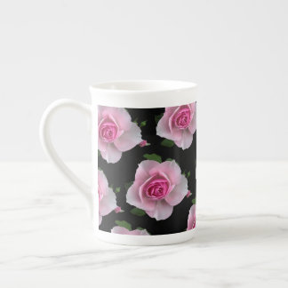 pink roses on black tea cup