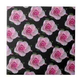 pink roses on black tile