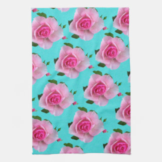 pink roses on teal kitchen towel
