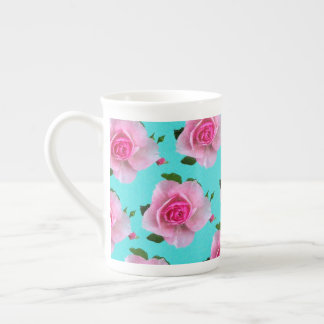 pink roses on teal tea cup