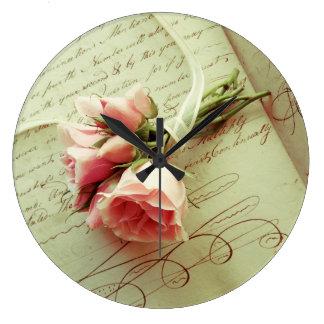 Pink roses with ribbon on old handwriting wallclocks