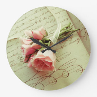 Pink roses with ribbon on old handwriting clocks