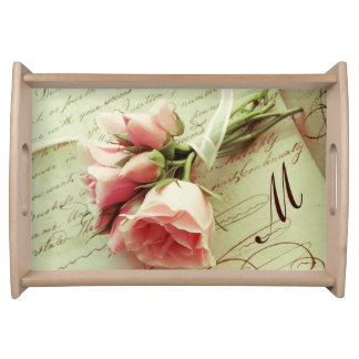 Pink roses with ribbon on old handwriting serving tray