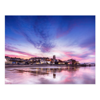 Pink sunset reflections over Cromer town at dusk Postcard