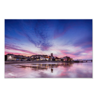 Pink sunset reflections over Cromer town at dusk Poster