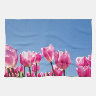Pink tulips field with blue sky kitchen towel