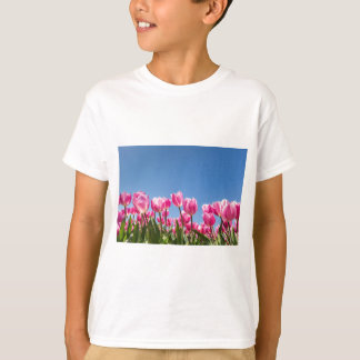 Pink tulips field with blue sky T-Shirt