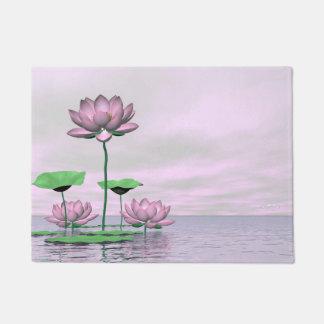 Pink waterlilies and lotus flowers - 3D render Doormat