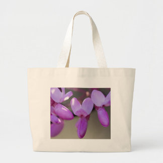 pink wisteria in the garden large tote bag