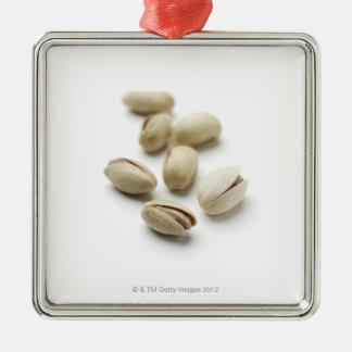 Pistachio nuts. Silver-Colored square ornament