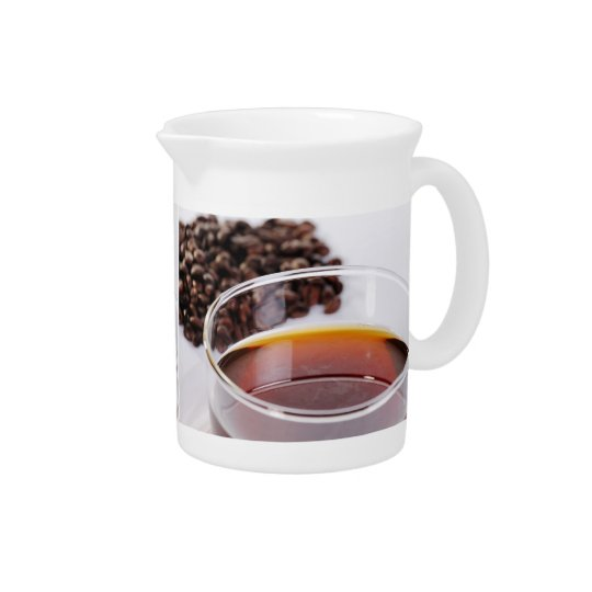 Pit Cher with Kaffebohnen and coffee cup Pitcher