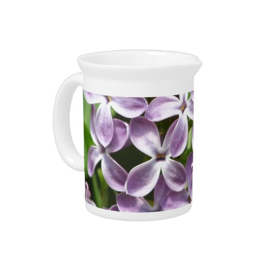pitcher with photo of beautiful purple lilacs
