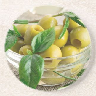 Pitted olives with green leaves and rosemary coaster