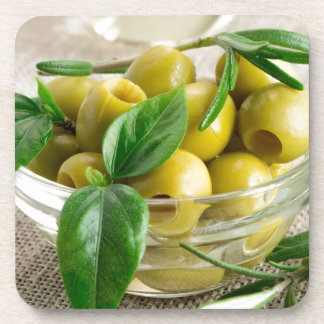 Pitted olives with green leaves and rosemary coasters