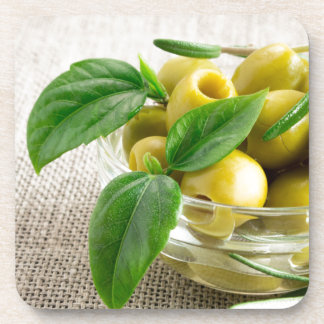 Pitted olives with green leaves and rosemary drink coaster