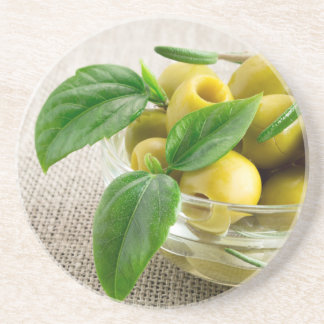 Pitted olives with green leaves and rosemary drink coasters