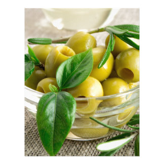 Pitted olives with green leaves and rosemary letterhead