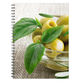 Pitted olives with green leaves and rosemary notebook