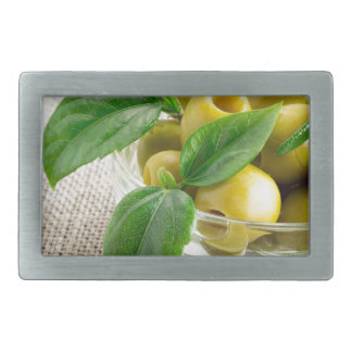 Pitted olives with green leaves and rosemary rectangular belt buckles
