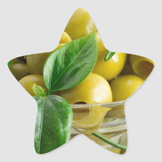 Pitted olives with green leaves and rosemary star sticker